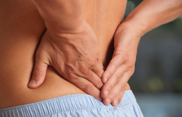 Holding-back-spine-issues.jpg