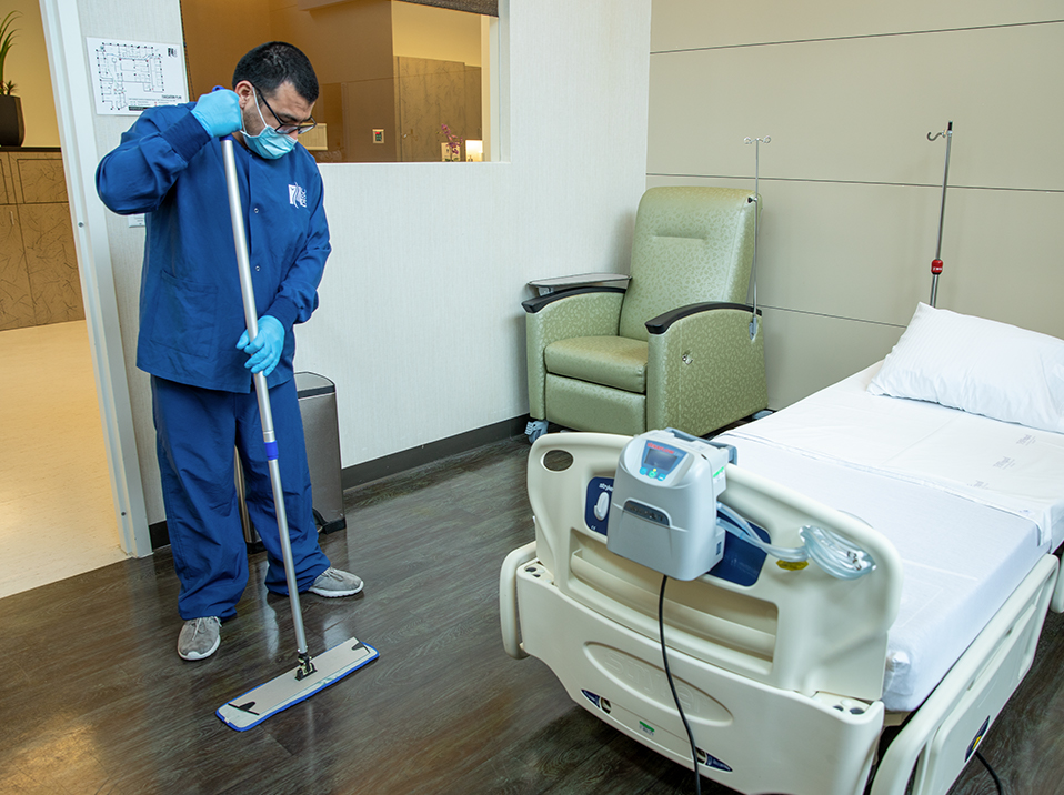 nurse sweeping the floor